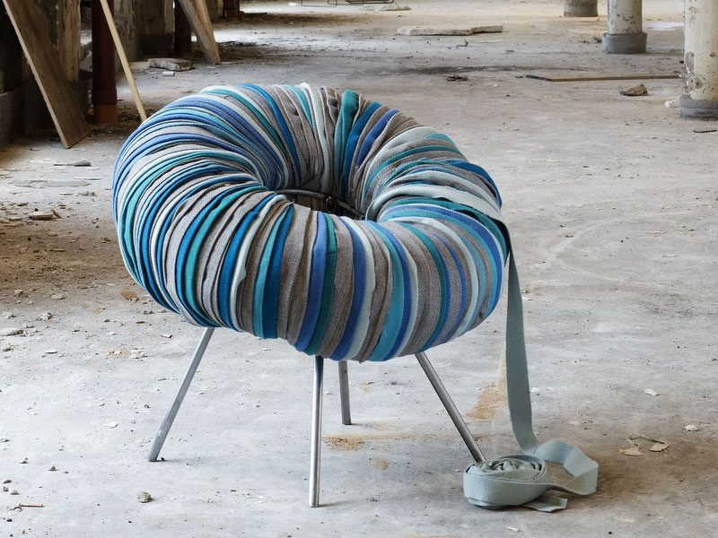 Furniture Ideas - 28 Accent Chairs For A Dramatic Living Room // Strips of fabric cover an inner tube that's been attached to the metal base to create a textured chair.