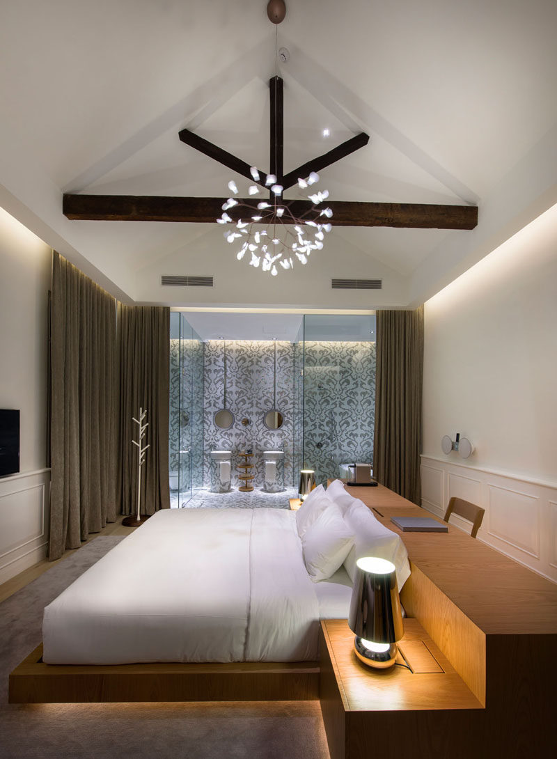 Hotel Room Design Ideas To Use In Your Own Bedroom // Place your bed in the middle of the room and put a desk behind it.