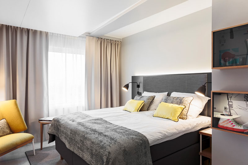 Hotel Room Design Ideas To Use In Your Own Bedroom // Add lots of elements of comfort like blankets, pillows and sheep skins, etc.