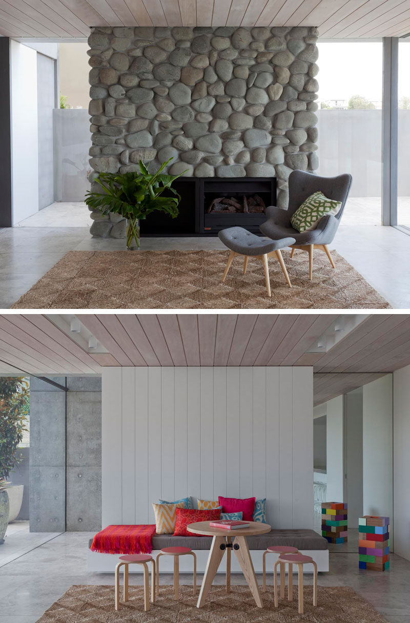 This casual living area has a fireplace surround made from river stones.