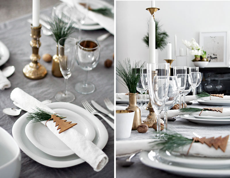 15 Inspirational Ideas For Creating A Modern Christmas Table Full Of Natural Elements // A simple wooden tree cut out secured around the napkin with twine and a sprig of greenery tucked between makes a simple and festive napkin holder.