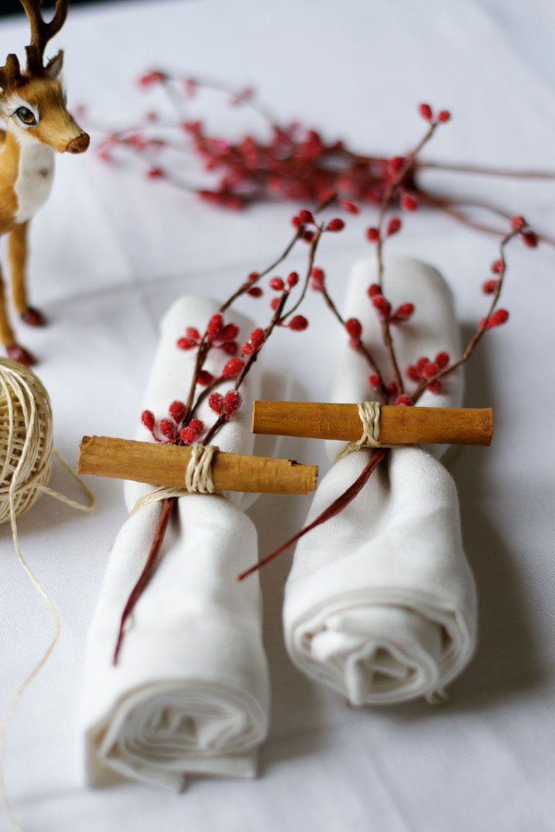 15 Inspirational Ideas For Creating A Modern Christmas Table Full Of Natural Elements // Cinnamon sticks and a small branch of berries secured to each napkin with twine or raffia keeps the table looking fun and the room smelling great.