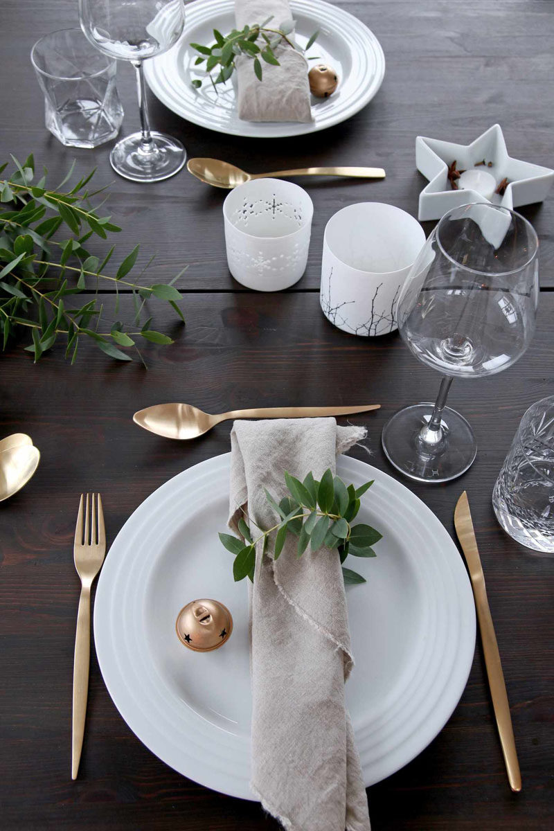 15 Inspirational Ideas For Creating A Modern Christmas Table Full Of Natural Elements // Strips of greenery wrapped and secured around a simple napkin keep the place setting natural and environmentally friendly.