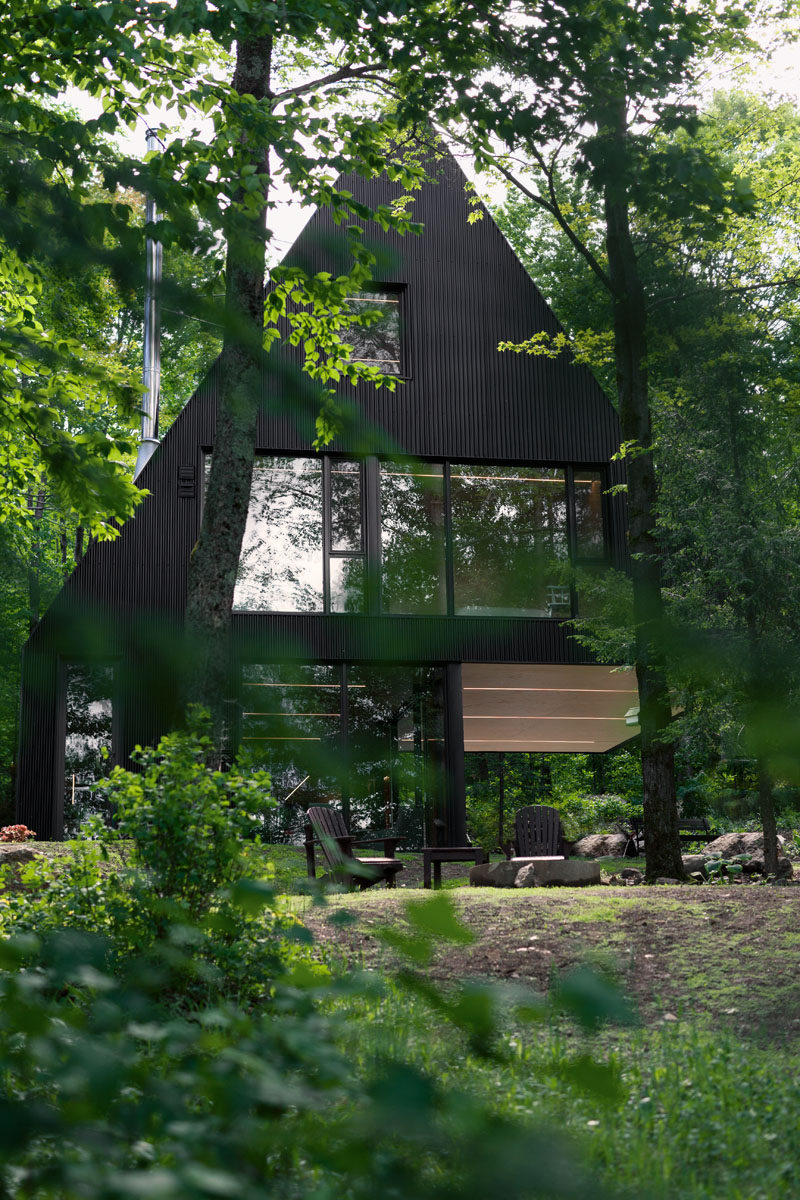 18 Modern House In The Forest // This black cabin is a summer home surrounded by a Hemlock forest in eastern Canada.