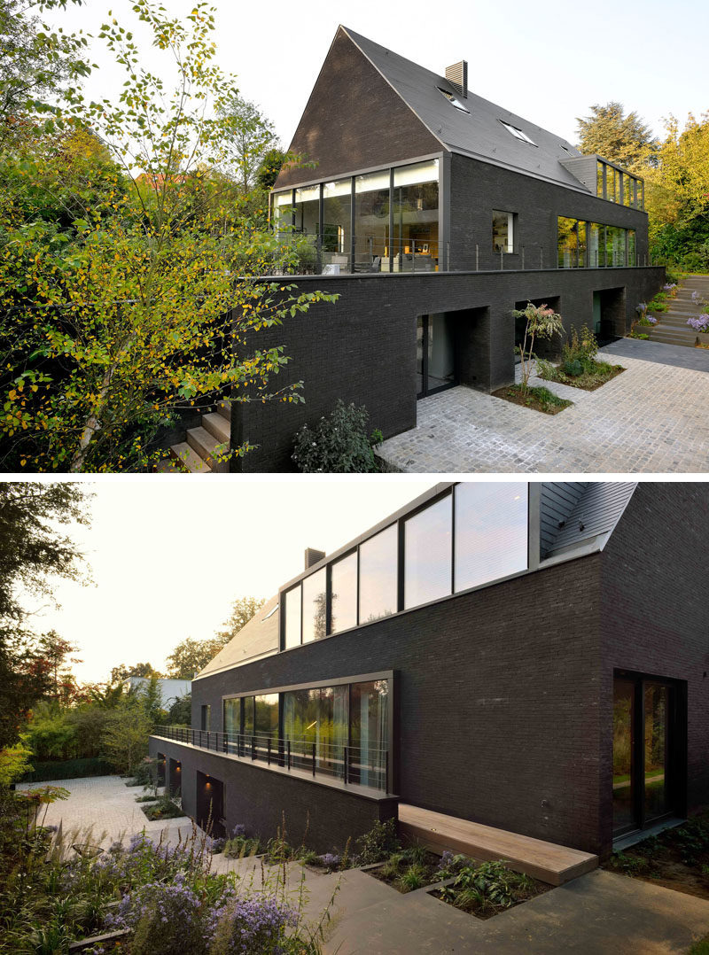 Architecture firm K2A have designed the renovation of a 1960s two-storey brick villa in Brussels, Belgium, which was originally white, and transformed it into this contemporary black house.