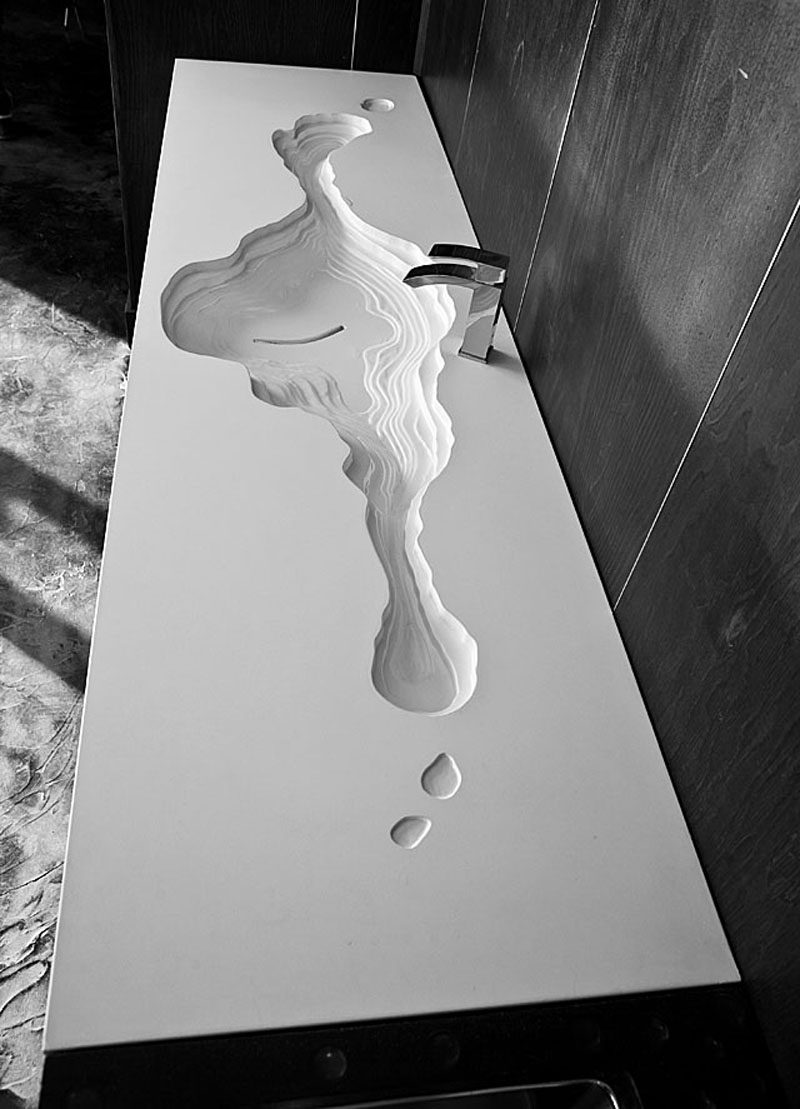 11 Creative Concrete Countertop Designs To Inspire You // This countertop features a topographical bathroom sink that also doubles as an artistic installation.