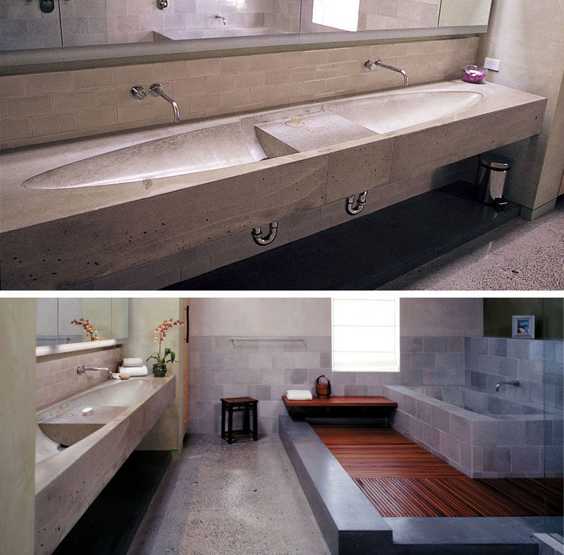 11 Creative Concrete Countertop Designs To Inspire You // This bathroom in a penthouse had a concrete countertop with dual sinks in an elliptical design.
