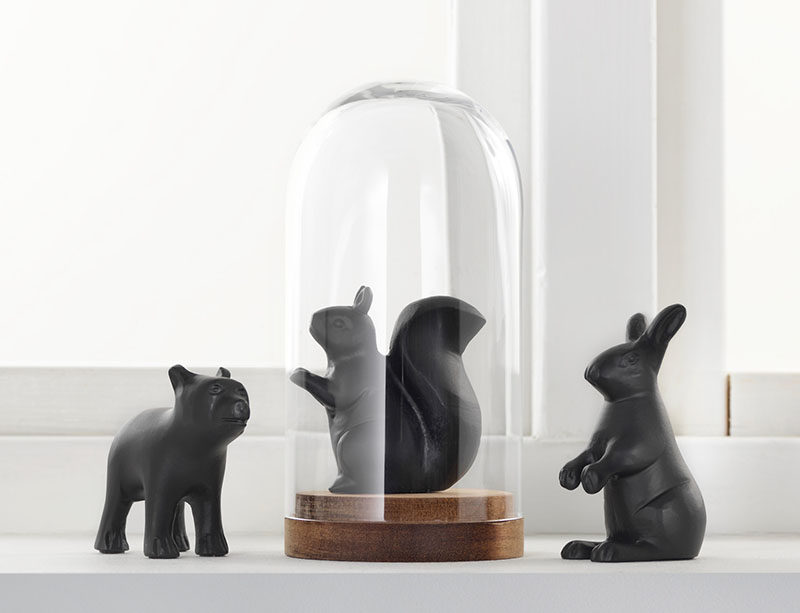 18 Decorative Animal Objects That Blur The Line Between Toys And Decor // Putting decorative animals under a glass dome adds even more of decorative feel to your display.
