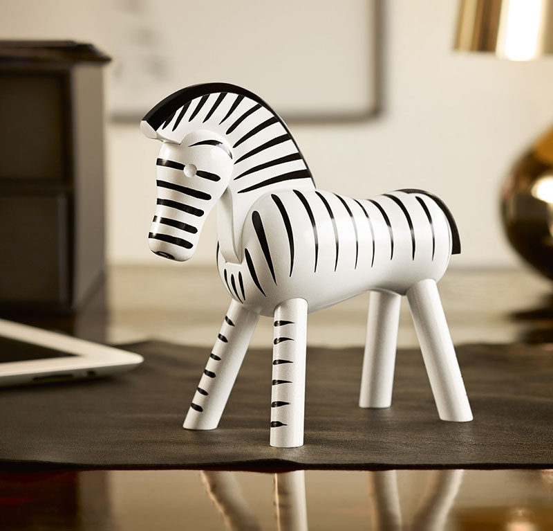 18 Decorative Animal Objects That Blur The Line Between Toys And Decor // This classic wooden zebra adds an exotic feel to your interior while keeping the space fresh looking with the simple black and white colors.