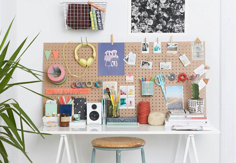 Desk Organization Ideas - 6 Easy Ways You Can Organize Your Desk To Make It More Inviting // Use your wall as an additional storage space.