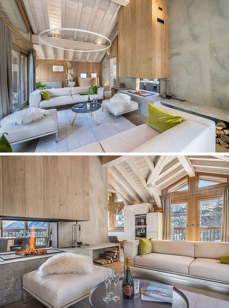 DOUBLE-SIDED FIREPLACE IDEA - This chalet has a contemporary interiors with separate dining and living areas, however they both get to enjoy the warmth of the double-sided fireplace.