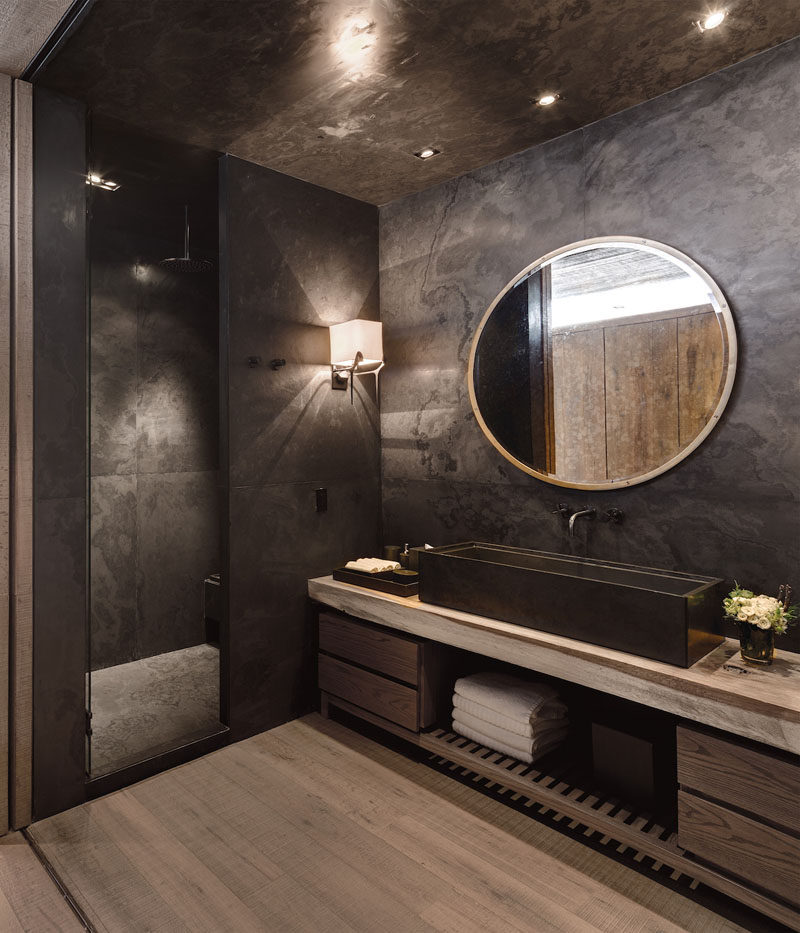 Bathroom Design Idea - Extra Large Sinks Or Trough Sinks (20 Pictures) // The long dark trough sink in this bathroom works with the rest of the dark colors in the room and makes the bathroom feel neutral yet warm.