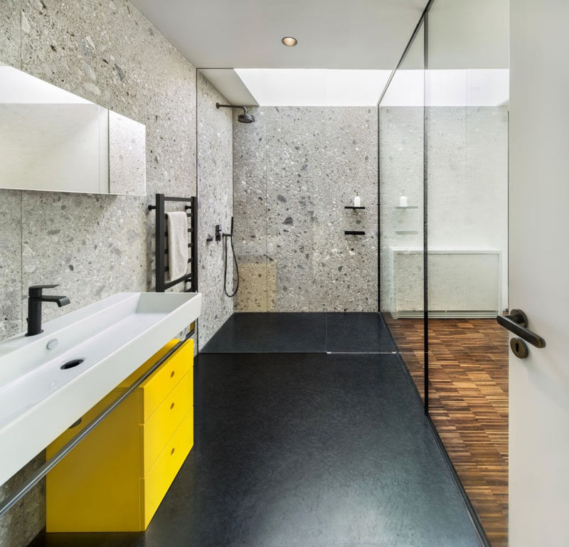 Bathroom Design Idea - Extra Large Sinks Or Trough Sinks (20 Pictures) // Matte black hardware and a bright yellow drawer unit coupled with the long white trough sink, give this bathroom a fun, modern vibe.