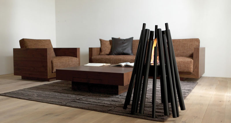 Warm Up Your Life With These 13 Freestanding Fireplace Designs // This freestanding fireplace is a modern take on the traditional pits made from a triangular arrangement of sticks and logs.