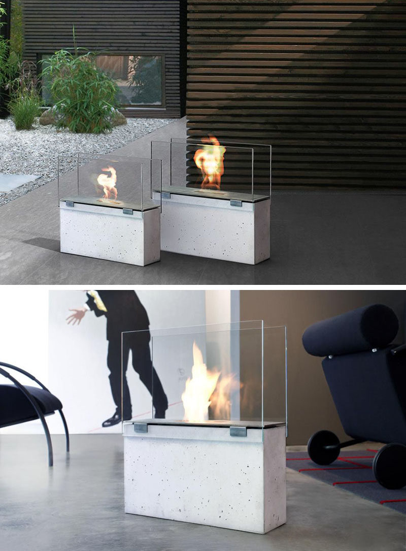 Warm Up Your Life With These 13 Freestanding Fireplace Designs // The concrete base of these freestanding fireplaces allow them to be placed on nearly any surface without having to worry about it getting too hot.