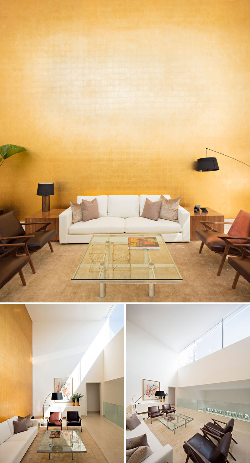 In this house, there's a reading area that has a wall covered in gold sheet that's a tribute to artist Mathias Goeritz. When the sun is shining, the gold reflects the glow into the main floor of the home.