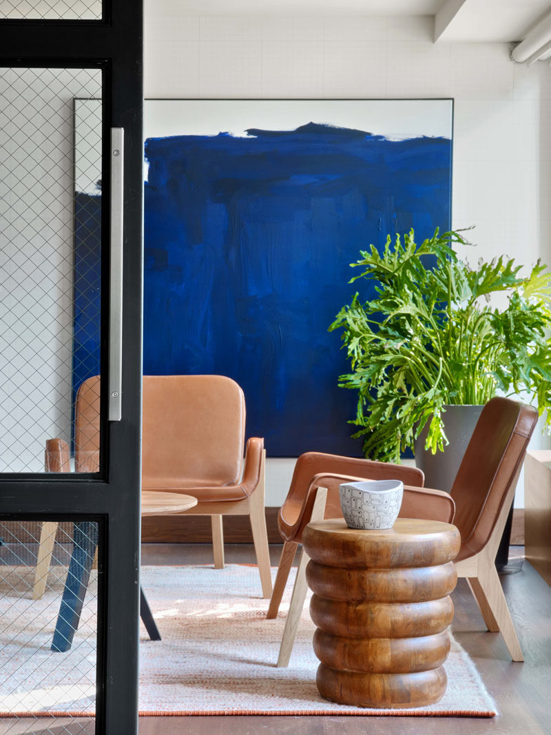 Comfortable seating has been paired with bold artwork and greenery for a relaxed contemporary look and feel.