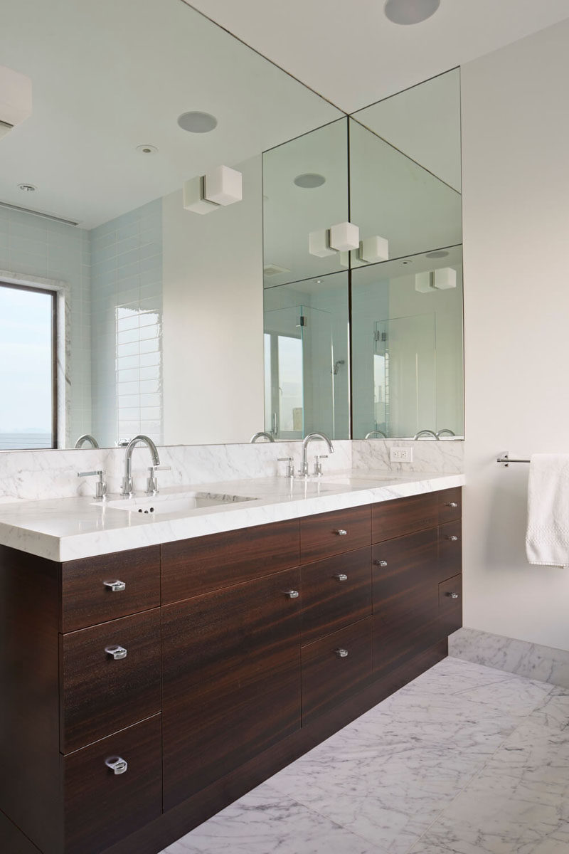 Bathroom Mirror Ideas - Fill The Wall // The large mirror in this bathroom wraps around just a little bit of the wall next to it to line up with the edge of the vanity.