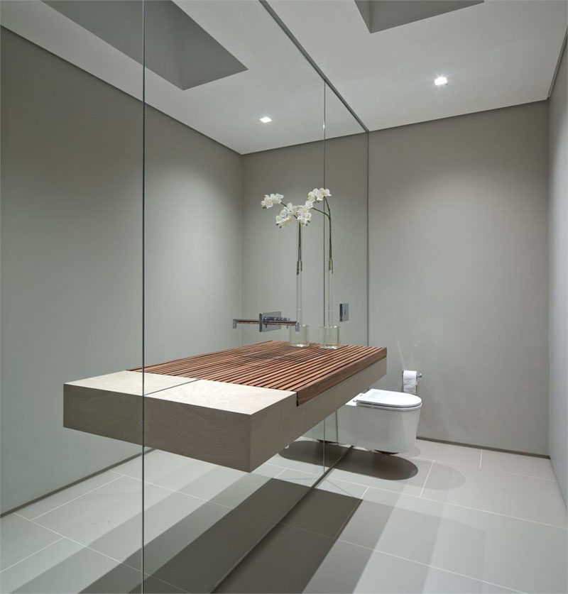 Bathroom Mirror Ideas - Fill The Wall // This wall of mirror makes the small bathroom seem much larger than it actually is and makes the sink appear to be a lot wider than it really is.