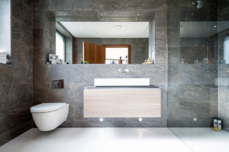 Bathroom Tile Ideas - Use Large Tiles On The Floor And Walls // These large wall tiles add texture to the bathroom and create just the right amount of contrast with the super smooth white floor.