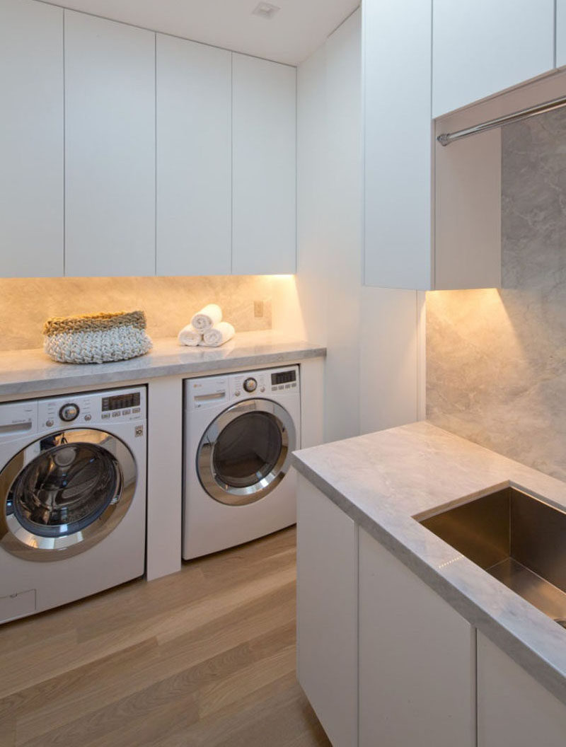 7 Laundry Room Design Ideas To Incorporate Into Your Own Laundry // Custom designed unit for housing the washer and dryer