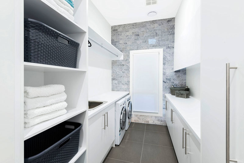 7 Laundry Room Design Ideas To Incorporate Into Your Own Laundry // Use baskets for organization