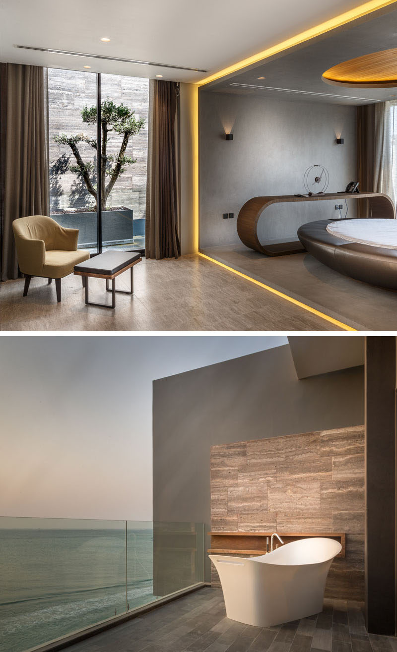 This bedroom has access to a small outdoor space and hidden lighting frames the sleeping area. On the balcony outside, there's a bathtub for relaxing.