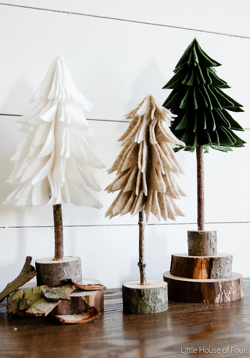 30 Modern Christmas Decor Ideas For Your Home // These felt and wood trees bring a bit of nature into your decor and help make your space feel warmer and more inviting.