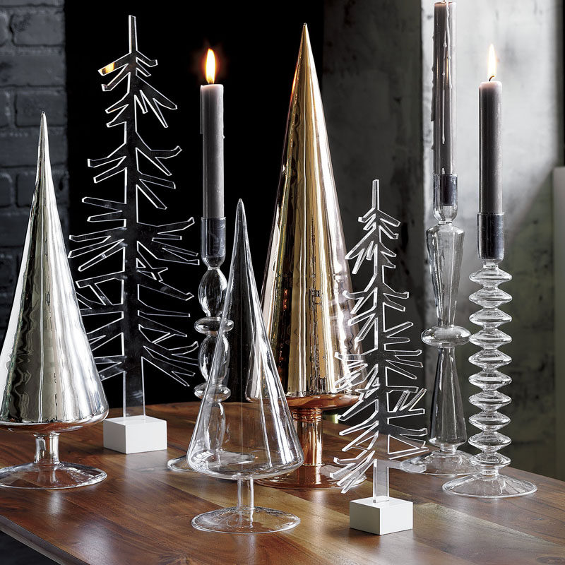 30 Modern Christmas Decor Ideas For Your Home // Glass trees organized on a table or mantle create a modern forest right inside your home.