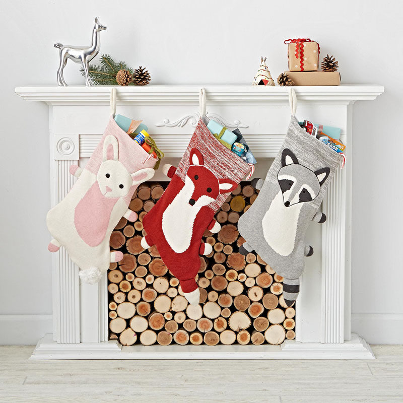30 Modern Christmas Decor Ideas For Your Home // These woodland stockings are an adorable addition to the mantle and are just the right size for tucking in a few Christmas treats.