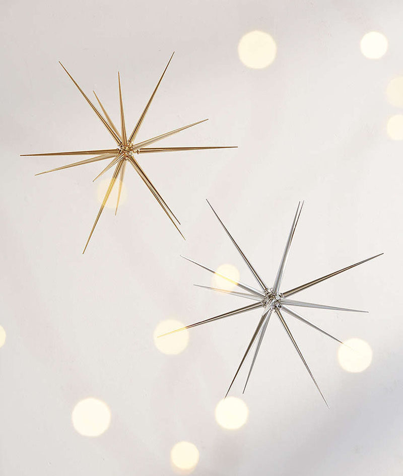 30 Modern Christmas Decor Ideas For Your Home // Hang a few of these silver and gold stars in your windows to create a festive, modern window display.