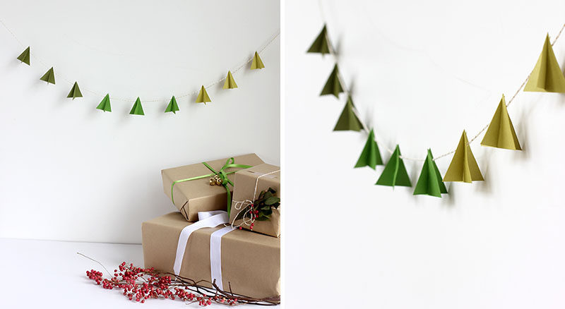 30 Modern Christmas Decor Ideas For Your Home // Add some minimal holiday decor to your walls with these paper Christmas trees hanging from festive string.