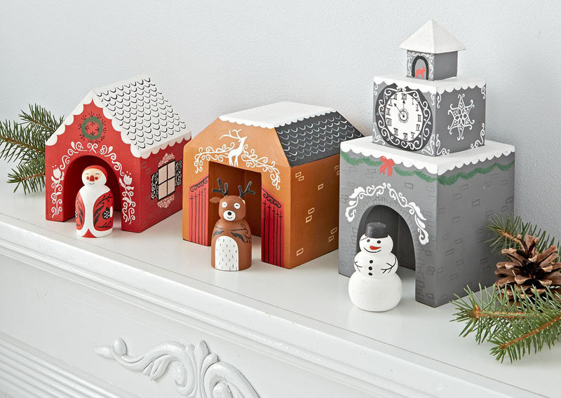 30 Modern Christmas Decor Ideas For Your Home // This colorful yet simple Christmas village would be perfect in kids rooms or playrooms that need a bit of festive decor.
