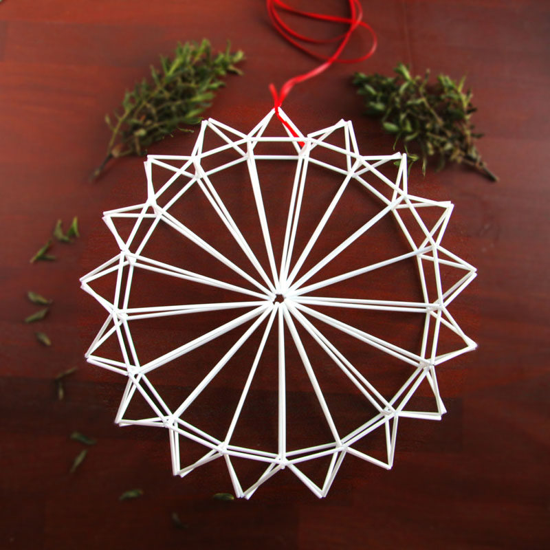 21 Modern Wreaths To Decorate Your Home With This Holiday Season // This white himmeli wreath would look just like a modern snowflake hanging from inside your window.