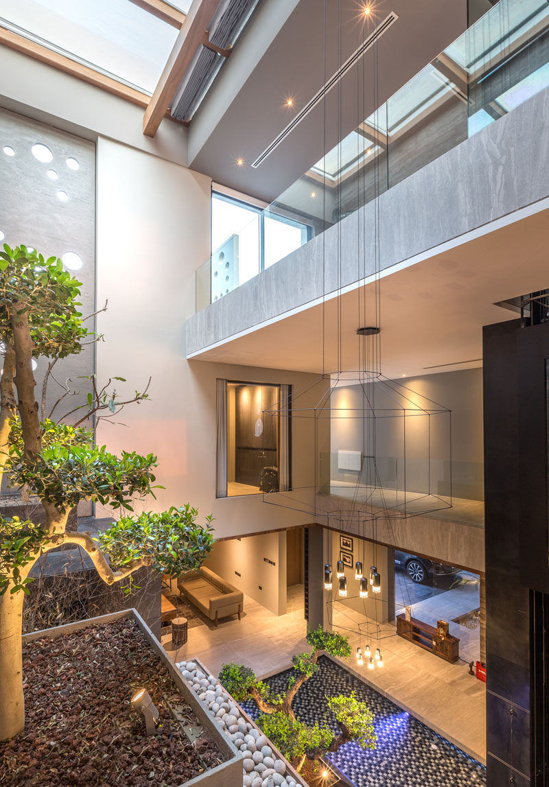From the lounge area of the master suite in this modern house you are able to see the courtyard below and the skylight above.
