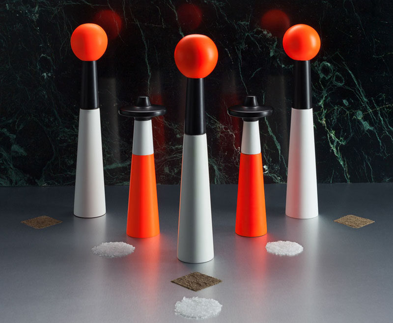 Essential Kitchen Tools - Salt and Pepper Mills // Add some architecture to your kitchen table with these tower grinders painted with white and fluorescent safety orange.