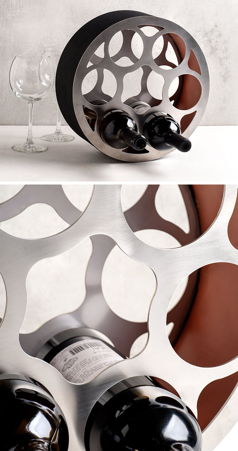13 Wine Bottle Storage Ideas For Your Stylish Home // A steel wine wheel like this one adds a unique design piece to your home and creates a stylish spot to store your bottles.