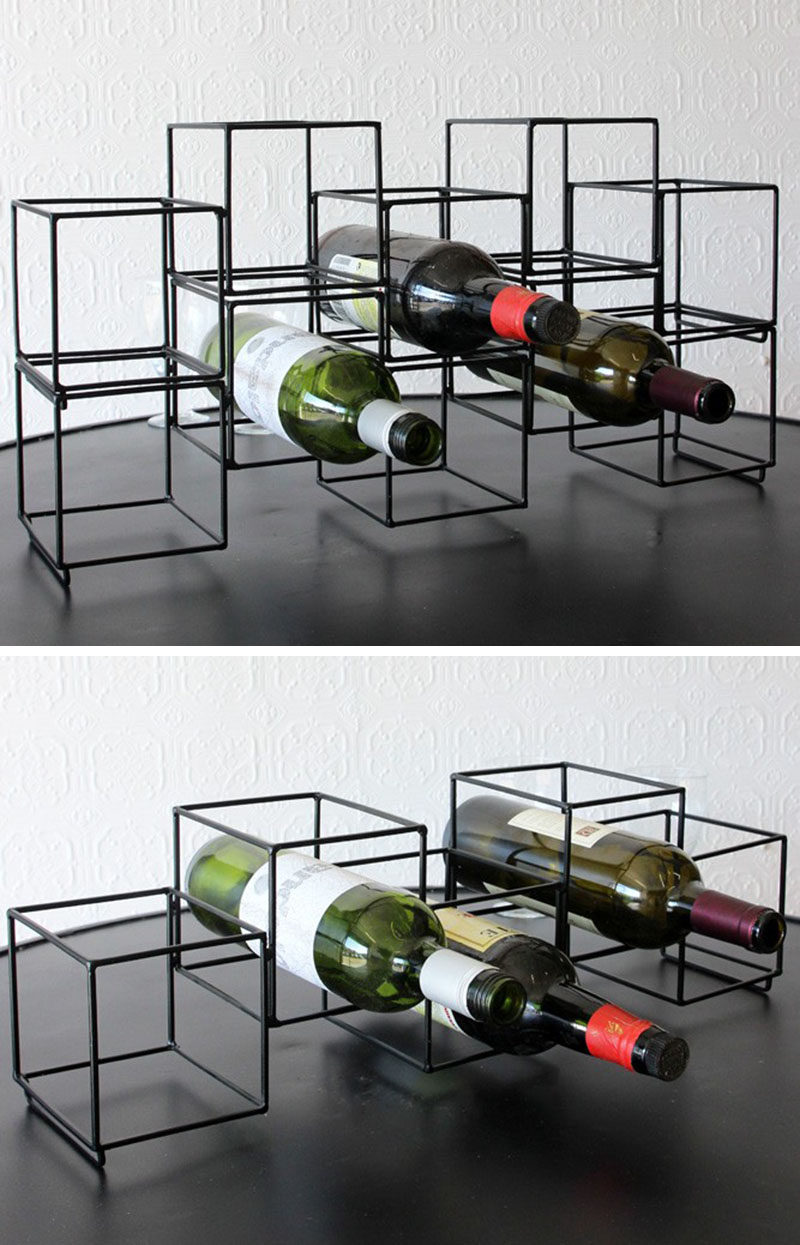 13 Wine Bottle Storage Ideas For Your Stylish Home // A single one of these matte black geometric wine racks lets you store 5 bottles of your favorite wine, but stack more of the holders on top of each other and you can store as much wine as you like.