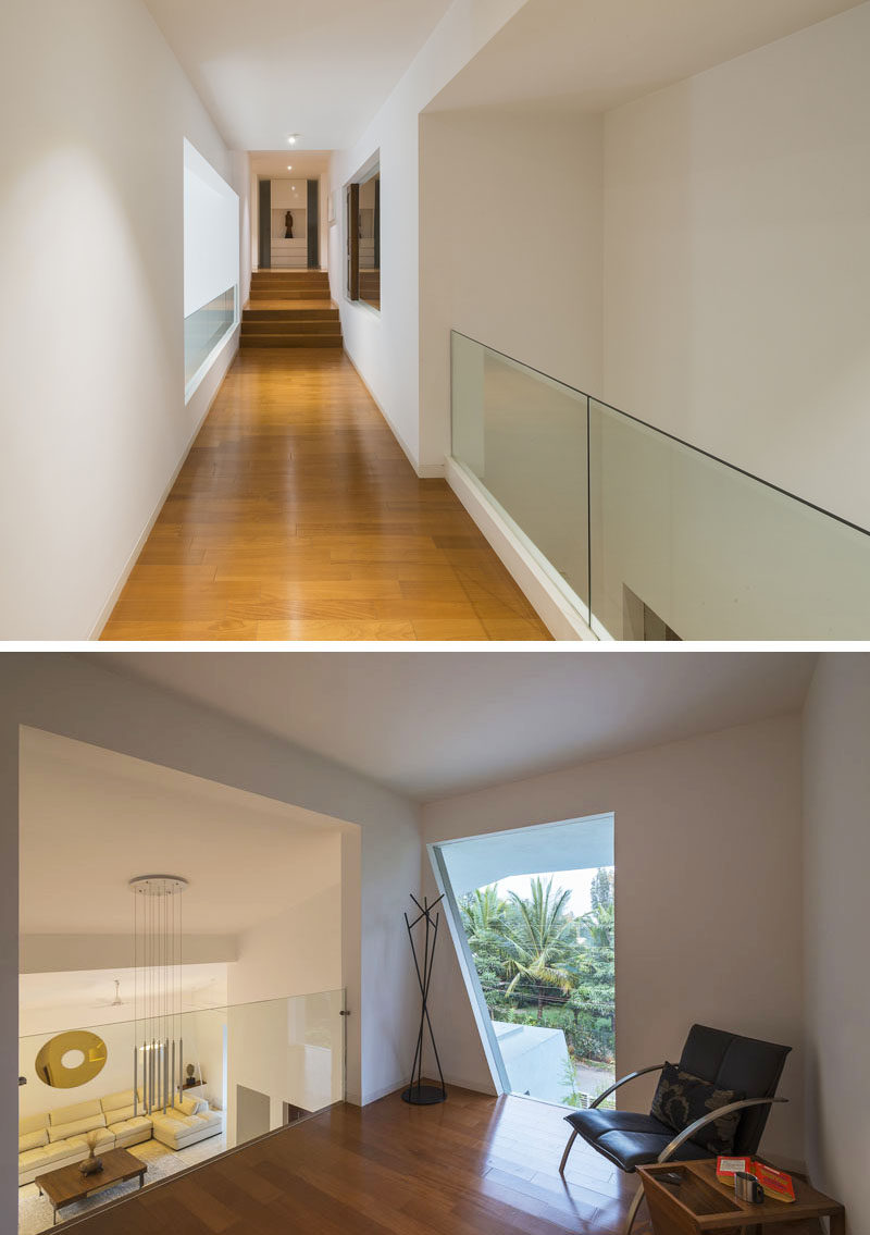This small sitting area at the end of a hallway overlooks the living room below.