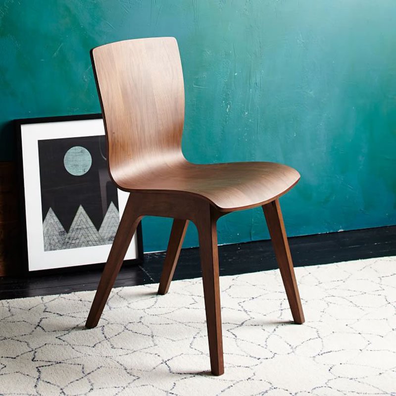 Furniture Ideas - 14 Modern Wood Chairs For Your Dining Room // The smooth curves of this dark wood chair make it a comfortable place to sit and eat and chat with friends and family.