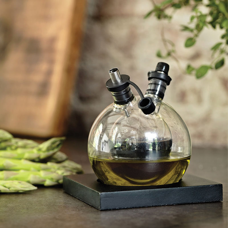 Essential Kitchen Tools - 11 Creative Oil & Vinegar Dispensers // This circular oil and vinegar set comes with a little base to help keep it upright and on display.