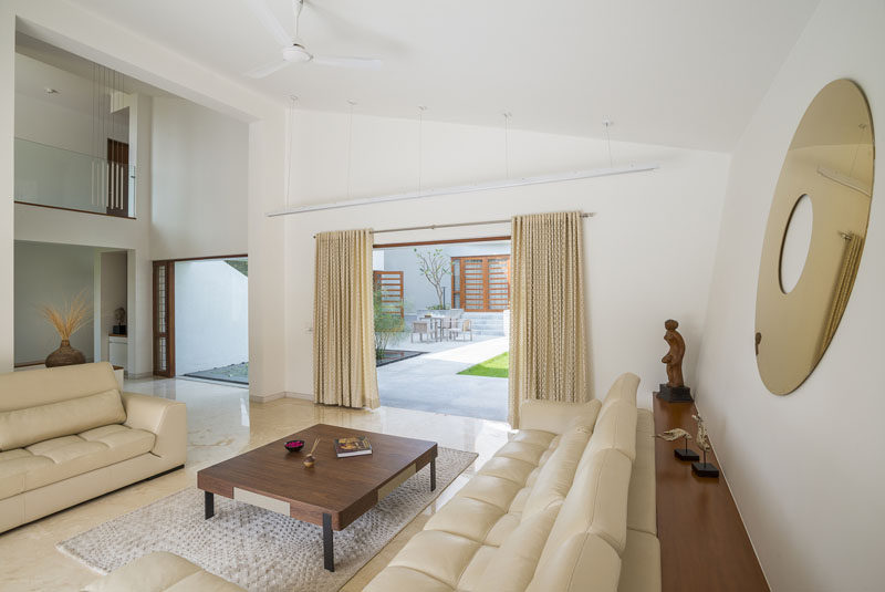 This living room has direct access to the backyard and water feature.