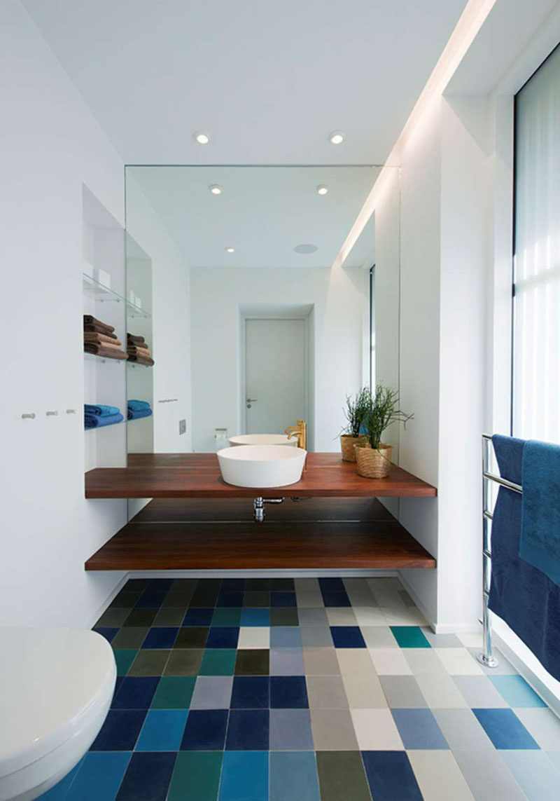 Bathroom Design Ideas - Open Shelf Below The Countertop // The wood counter and shelf in this bathroom add warmth to the colorful space and provide a convenient place to store all your bathroom essentials.
