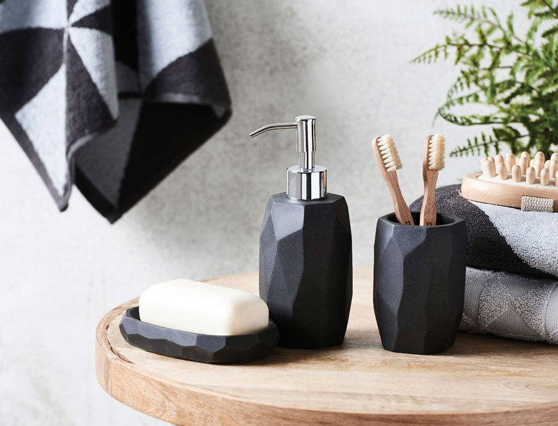 Bathroom Decor Ideas- Sophisticated Soap Dispensers // The geometric look of this soap dispenser makes it great for modern spaces while the dark grey color gives it a grown up feel.