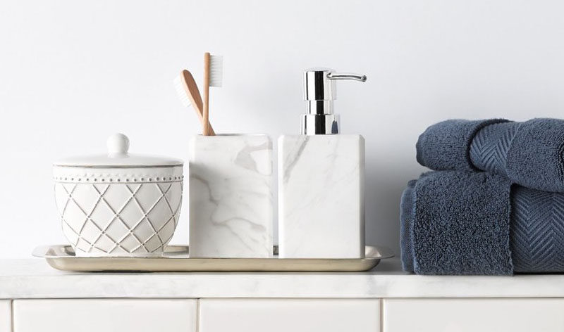 Bathroom Decor Ideas- Sophisticated Soap Dispensers // A simple white marble soap dispenser adds class to your counter and makes washing your hands feel like a luxury.