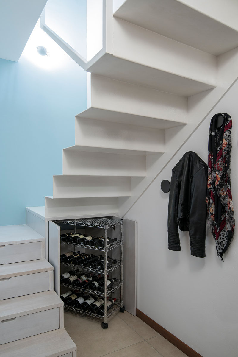 Stairs Design Idea - Hide Shoe And Wine Storage Within Your Stairs // Under the landing of this staircase two doors open up to reveal a storage cupboard that is just the right size to fit a wine cart stocked with all your favorite bottles of wine.