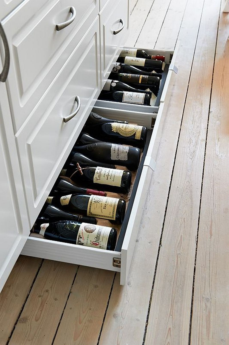 Kitchen Design Idea - Toe Kick Drawers // They are perfect for wine storage.