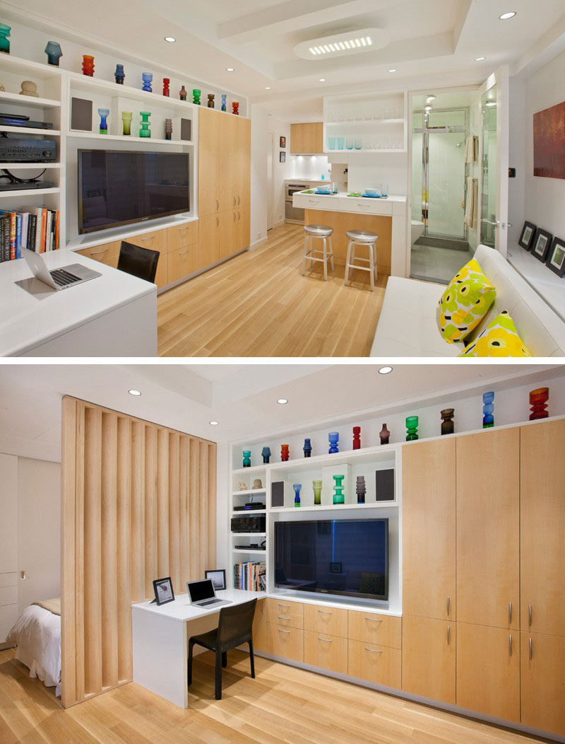 8 TV Wall Design Ideas For Your Living Room // With cupboards on one side, drawers below, and open shelving on the other size and above, this TV is completely surrounded by storage solutions.