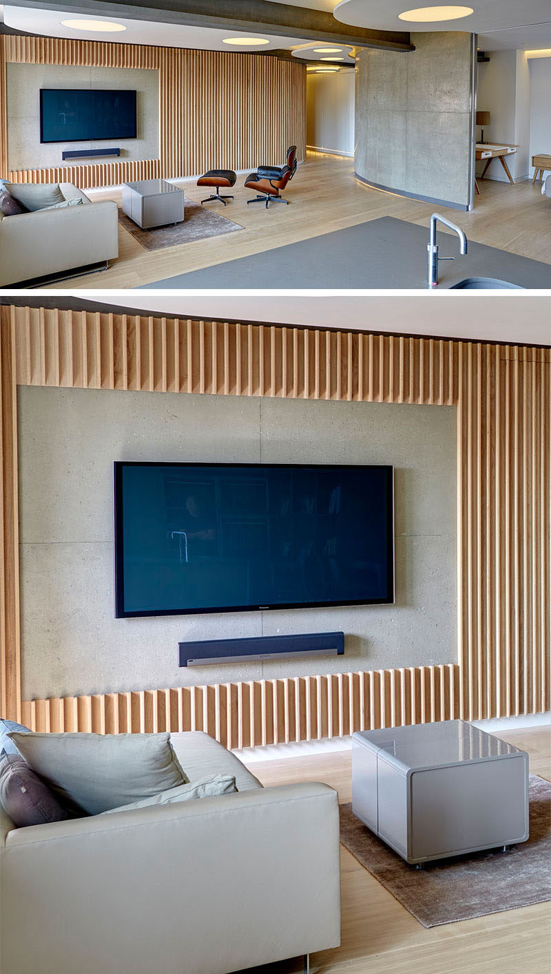 8 TV Wall Design Ideas For Your Living Room // Thin wood panels have been cut to frame the TV and sound bar to make it the main feature in the room.
