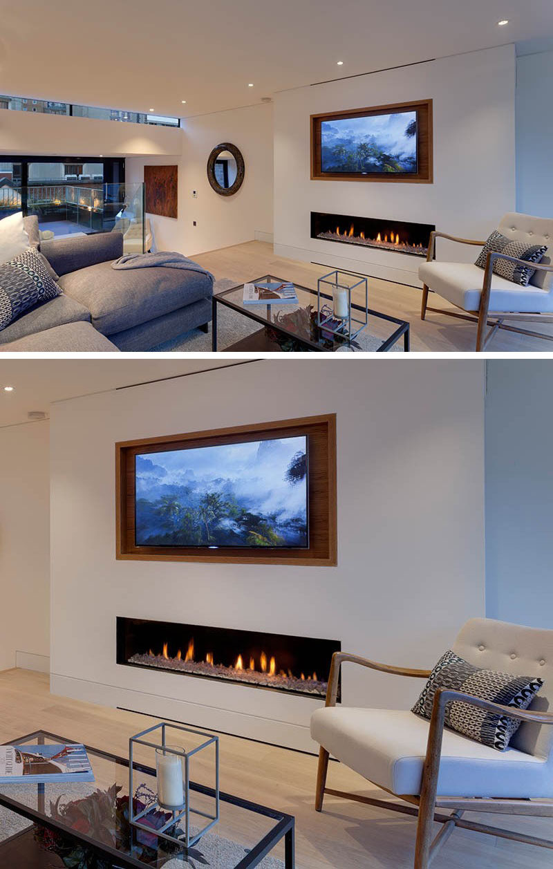 8 TV Wall Design Ideas For Your Living Room // The wooden frame around this TV makes it take up less space in the room and turns the TV into a piece of art when photos occupy the screen instead of shows or movies.